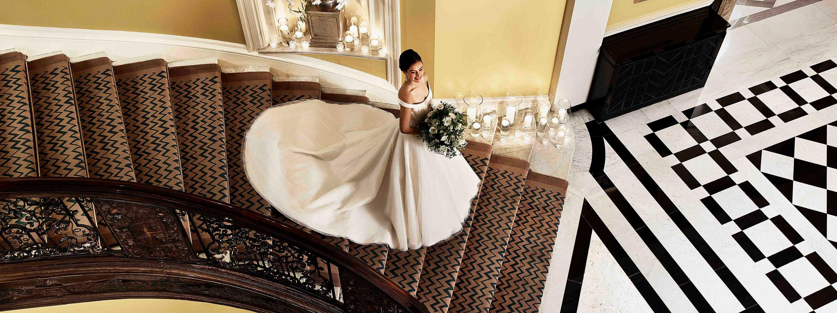 Bride coming down the Claridge's staircase
