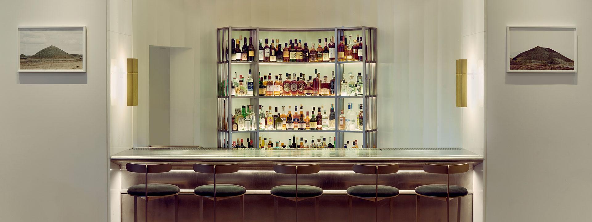 Bar counter, stools and spirits on display at Davies and Brook Bar in Mayfair at Claridge's