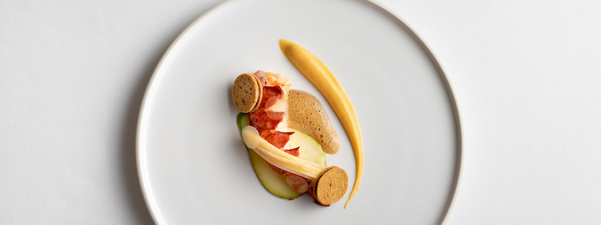 Poached lobster with swede, pear and lobster bisque at Davies and Brook restaurant in Mayfair