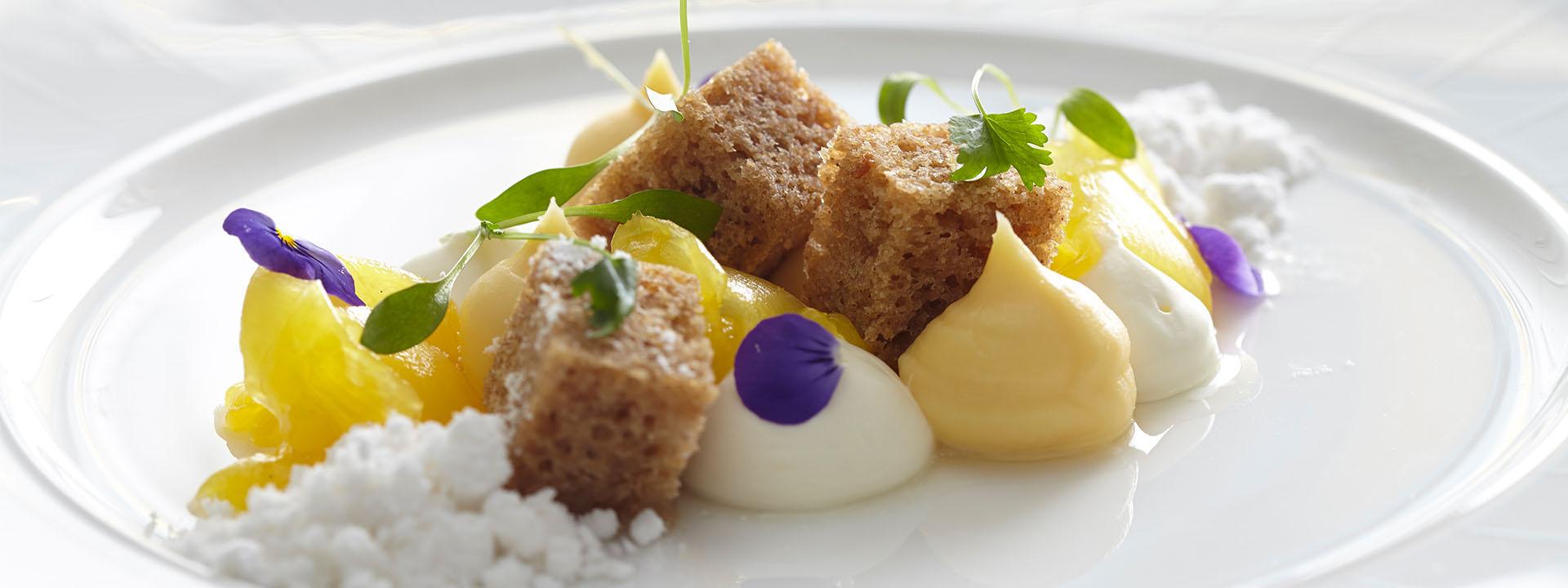 Cubes of sponge cake dessert at The Foyer & Reading Room restaurant in Mayfair at Claridge's